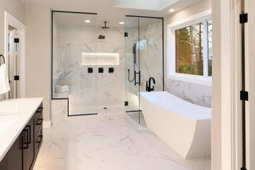 bathroom with installed wall and floor tiles